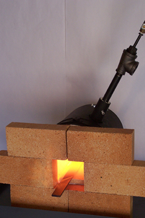 this is a side view of the forge running
